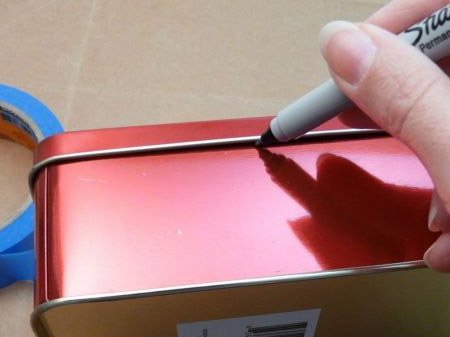 With the lid on, use a permanent marker to draw a line where the lids fits onto the bottom section.