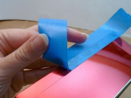 Place a strip of masking tape