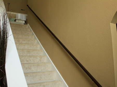 Here's an easy way to add interest to a bland staircase, using moulding and trim that you can buy at any Builders.