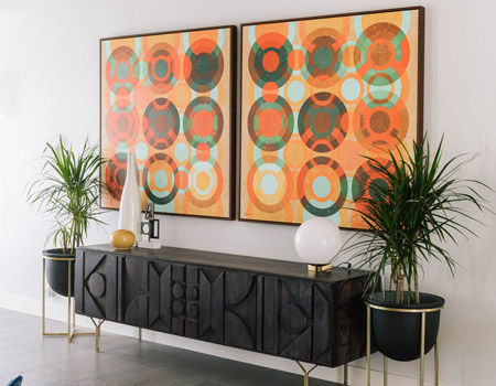 Let your artwork define the space. Hanging art on the walls creates a dynamic space, and art is a reflection of your style and personality.