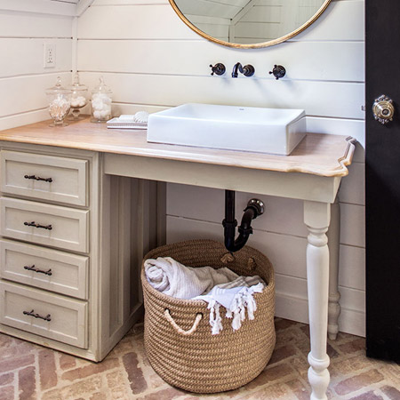 The sink vanity is one that was a secondhand find restored with paint