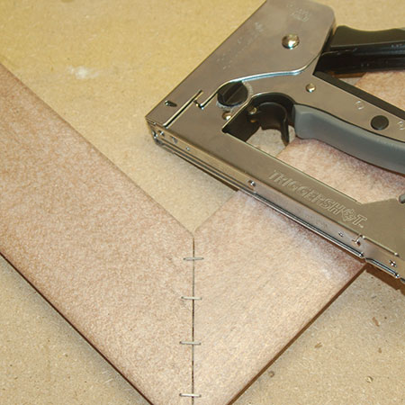 use a heavy-duty stapler to secure frame corners