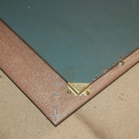 use corner brackets to secure mirror in place