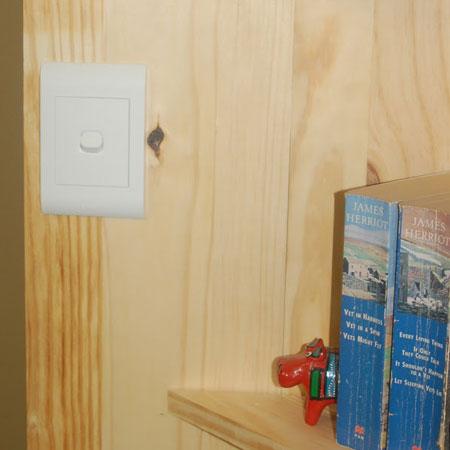 hygge pine bookshelf with built-in spotlight
