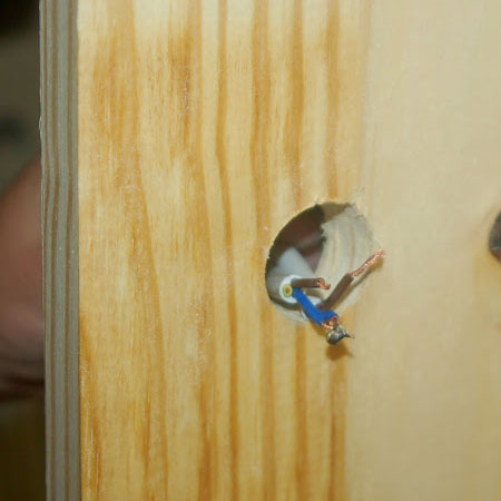 push electrical wires through drilled hole