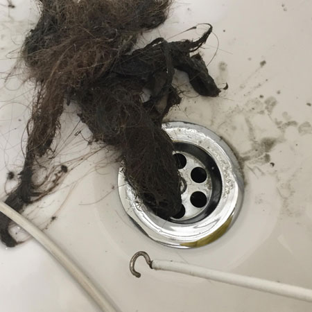 hooked curtain wire removes hair in drains