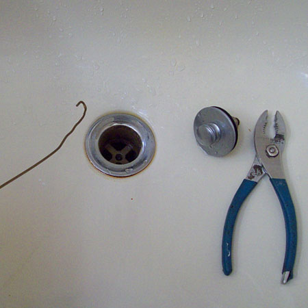 bend coathanger to remove hair from blocked drain