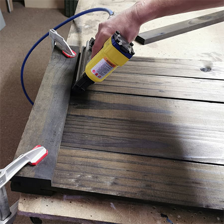use pneumatic nailer to secure wood planks