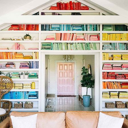 arrange books in a colourful display