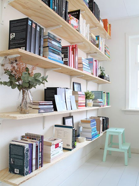 arrange books in piles and stacks