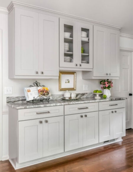 tiny pantry replaced by custom cabinetry in kitchen