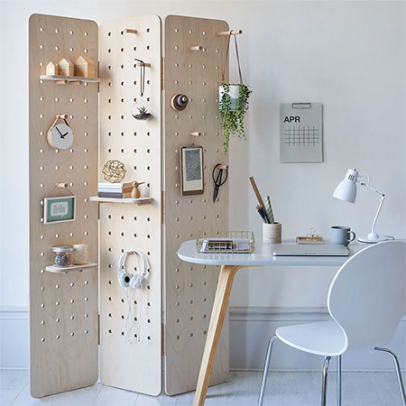 pegboard wall or room divider with shelves