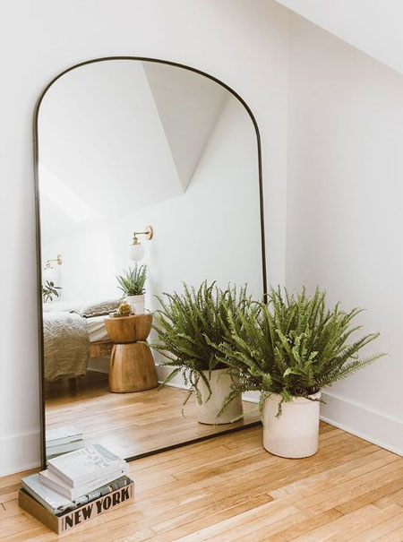 mirror makes bedroom feel larger