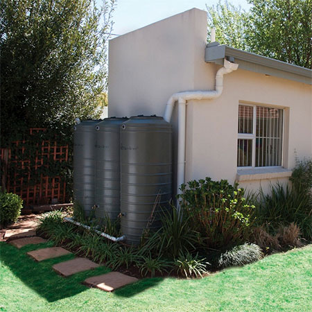 a rainwater tanks collects rain in summer for use in winter