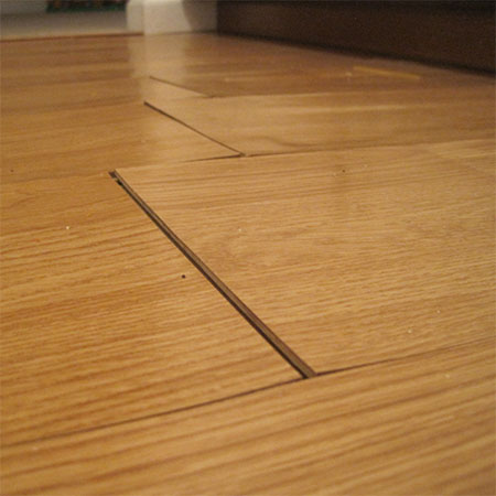 laminate floor lifting water damage