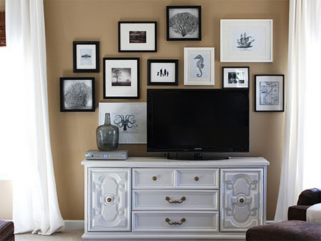 ABOVE: The placement of this TV grabs attention but it's not the first  thing you see. The arrangement of art and the beautiful TV cabinet visually  demand ...