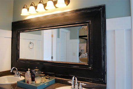 Framed mirror in bathroom