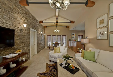 In A Lounge With A Fitted Fireplace, Or Even A Free Standing Fireplace, A Rock  Wall Is The Perfect Element To Combine The Beauty Of Stone And Fire.
